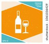 bottle of wine and wineglass... | Shutterstock .eps vector #1061036429