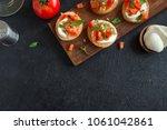 italian bruschetta with chopped ... | Shutterstock . vector #1061042861