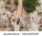 top view pick up truck off road ... | Shutterstock . vector #1061049209