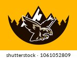the logo of a flying hawk  on... | Shutterstock .eps vector #1061052809