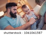 father and son playing with... | Shutterstock . vector #1061061587