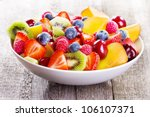 salad with fresh fruits and... | Shutterstock . vector #106107371