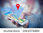 hand held phone with gps or... | Shutterstock . vector #1061076884