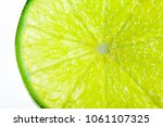 macro juicy slice of lime... | Shutterstock . vector #1061107325
