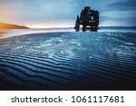 attractive dark sand after the... | Shutterstock . vector #1061117681
