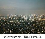 night cityscape of modern... | Shutterstock . vector #1061119631