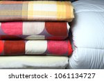 folded quilt in dry cleaner's | Shutterstock . vector #1061134727