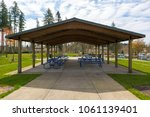 picnic tables under wooden roof ... | Shutterstock . vector #1061139401