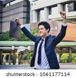 young business with hand holds ... | Shutterstock . vector #1061177114