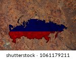 map and flag of russia on rusty ... | Shutterstock . vector #1061179211
