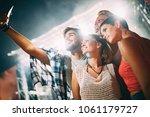 happy friends taking selfie at... | Shutterstock . vector #1061179727