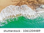 emerald green sea and orange... | Shutterstock . vector #1061204489