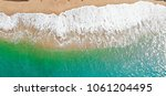 emerald green sea and orange... | Shutterstock . vector #1061204495