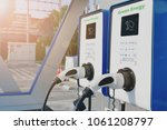 electric vehicle charging  ev ... | Shutterstock . vector #1061208797