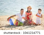 cheerful family eating... | Shutterstock . vector #1061216771