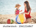 young pretty mother playing... | Shutterstock . vector #1061216867