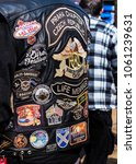 Small photo of Podebrady, Czech republic - March 31, 2018: Embroidery on the back of a biker jacket in a gathering of American motorcycles. chapter Harley Owners Group. Different stripes or signs on leather jacket.