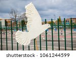 Aldermaston, United Kingdom, 1st April 2018:- A paper dove of peace outside the main gate to the AWE where Britains nuclear warheads are made, on the 60th anniversary of the first CND march in 1958 - stock photo