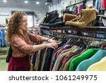 woman browsing through vintage... | Shutterstock . vector #1061249975