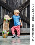 little skater with skateboard... | Shutterstock . vector #1061252777