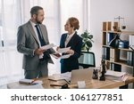 lawyers in suits working... | Shutterstock . vector #1061277851