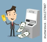 credit card into atm and takes... | Shutterstock .eps vector #1061277887