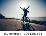silhouette of happy cyclist... | Shutterstock . vector #1061281931