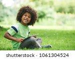 young boy using digital tablet... | Shutterstock . vector #1061304524