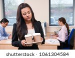 fed up female intern fetching... | Shutterstock . vector #1061304584