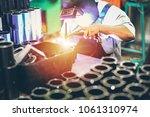 industrial worker in... | Shutterstock . vector #1061310974