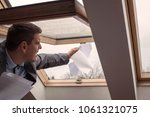 Small photo of Businessman throwing paper throw window.