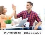 happy young couple giving each... | Shutterstock . vector #1061321279