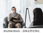 male therapist in glasses...   Shutterstock . vector #1061351561