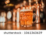 a refreshing pint of beer on a... | Shutterstock . vector #1061363639
