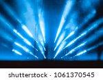 spotlight in smoke | Shutterstock . vector #1061370545