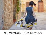 attractive woman tourist with... | Shutterstock . vector #1061379029
