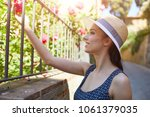 attractive woman tourist with... | Shutterstock . vector #1061379035