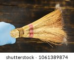 cleaning. broom sweeps out the... | Shutterstock . vector #1061389874
