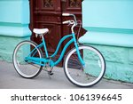 vintage turquoise bicycle with... | Shutterstock . vector #1061396645