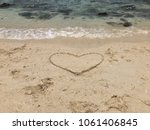 draw heart on the sand of the... | Shutterstock . vector #1061406845