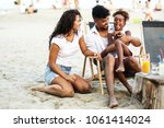 young mixed race family sitting ... | Shutterstock . vector #1061414024