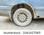 wing rusty  the car is... | Shutterstock . vector #1061427065