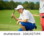 asian golfer crouching and... | Shutterstock . vector #1061427194