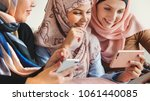 islamic women using smartphones | Shutterstock . vector #1061440085