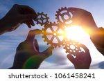 four hands of businessmen... | Shutterstock . vector #1061458241