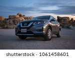 Small photo of Joshua Tree National Park, California - November 2, 2017: View of a grey 2017 Nissan Rogue in the desert.