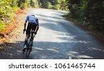 asian men are cycling road bike ... | Shutterstock . vector #1061465744