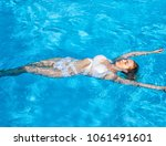 beautiful young slim woman... | Shutterstock . vector #1061491601