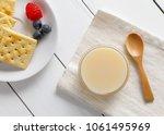 crackers with condensed milk... | Shutterstock . vector #1061495969