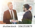 business colleagues talking in... | Shutterstock . vector #1061510879